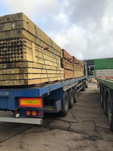 mixed fence posts on a lorry